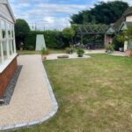 Resin bond patio and paths with brick surround
